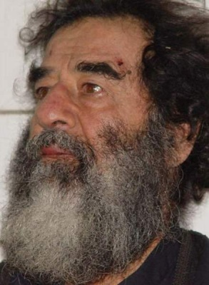 This is a photo of either a Linux programmer or Saddam Hussein.